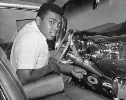 Muhammad Ali With A Record Player In His Car Listening