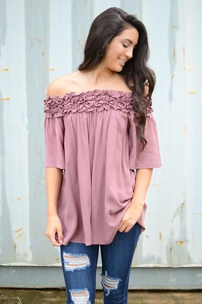 How unique is this off the shoulder top featured in a dusty mauve color? By She   Sky, this half sleeve beauty features ruffles across the entire neckline. You're sure to be the epitome of class and s