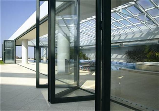 The folding doors (accordion type), are responding to the needs that mainly business spaces have. Systems of this type are ideal for covering large openings such as car showrooms, restaurants, entertaining areas, etc. there is a requirement for flexible space with movable partitions.   For Further information visit our website: http://www.alumil.com/en/products/doors-windows/folding-doors/