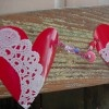 Valentine's Day is the perfect time to make recycled plastic crafts! Grab a stack of cups and make a fun and whimsy garland to hang in your home. A Red Plastic Cup Heart Garland is the perfect addition to any space, big or small.