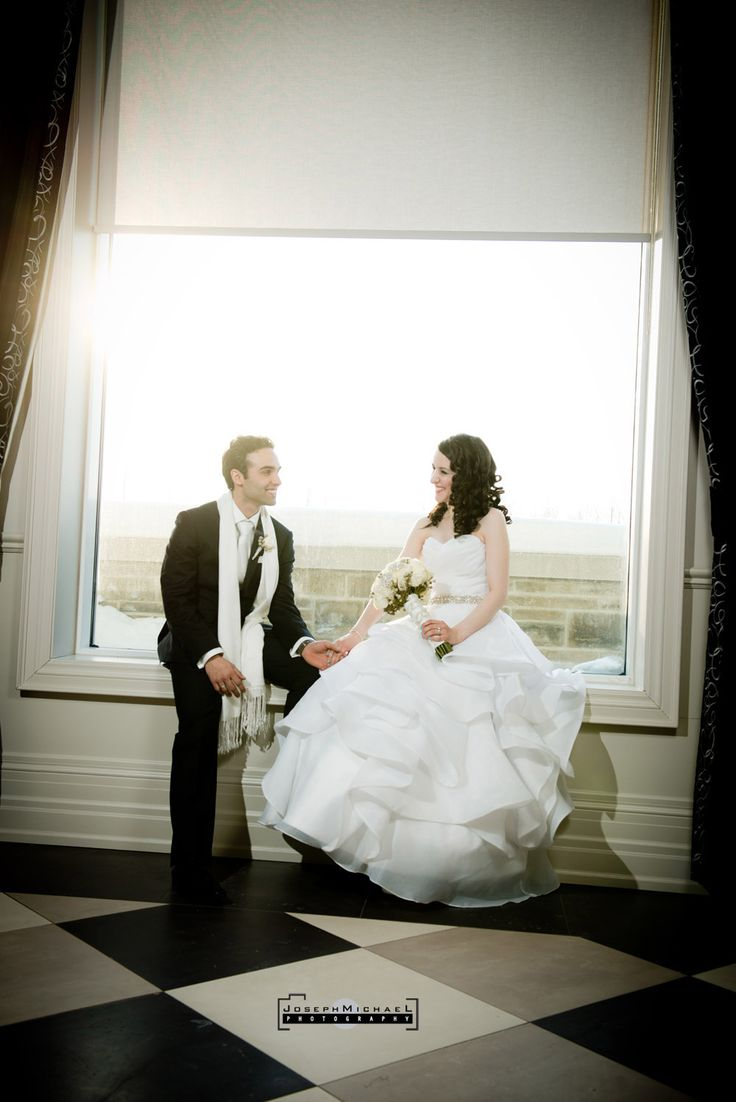 Hazelton Manor Wedding Photography, Winter Wedding, Snow, Bride and Groom at Window, Bride and Groom Looking at Each Other