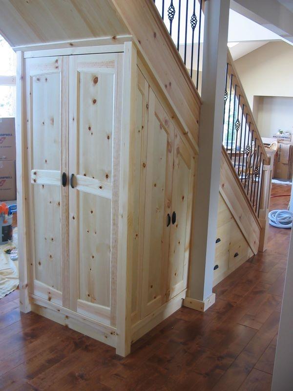 Under-stair storage http://www.hamiltonsbuiltins.com/builtinsandmantles/images/under_stair_custom_storage_in_knotty_pine.jpg