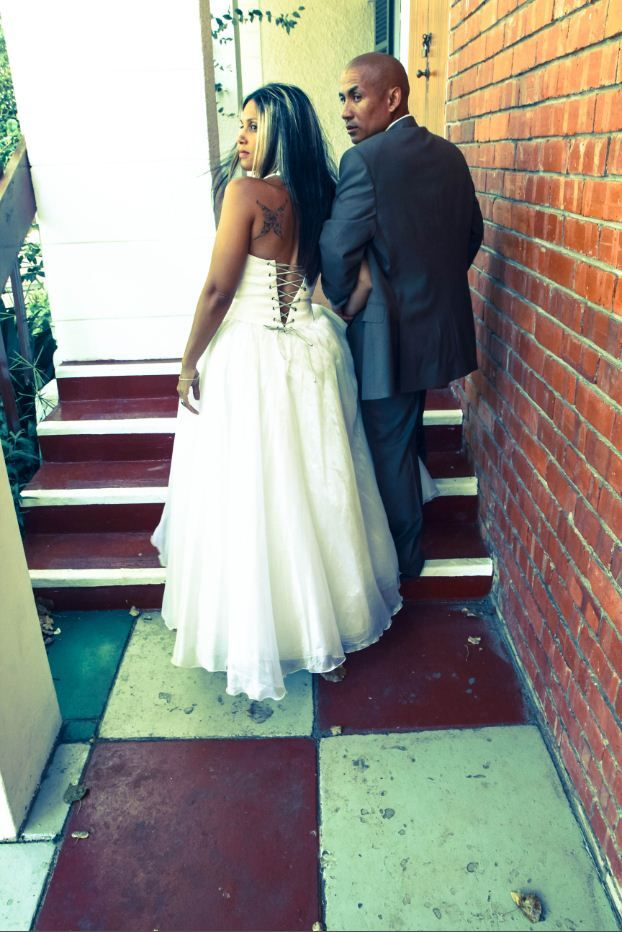 beautiful organza wedding dress with silver lace up detail and Carducci C Squared suit www.lovemade2me.com