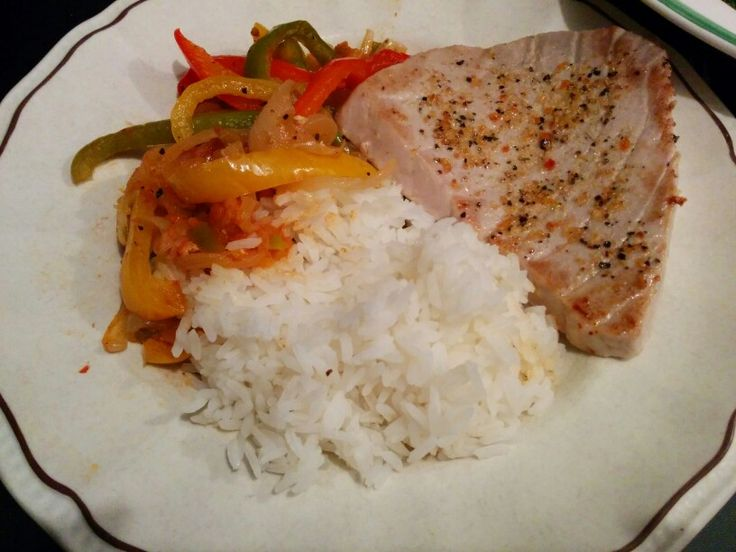 tuna steak served with peppers and rice foodies