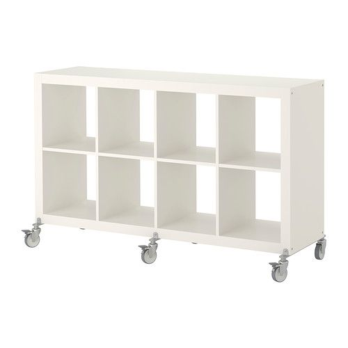 expedit shelving unit on casters. Ikea $109.99 - move this to living room for bar and the current birch one to baby room and put under window with chair infront in corner of room.