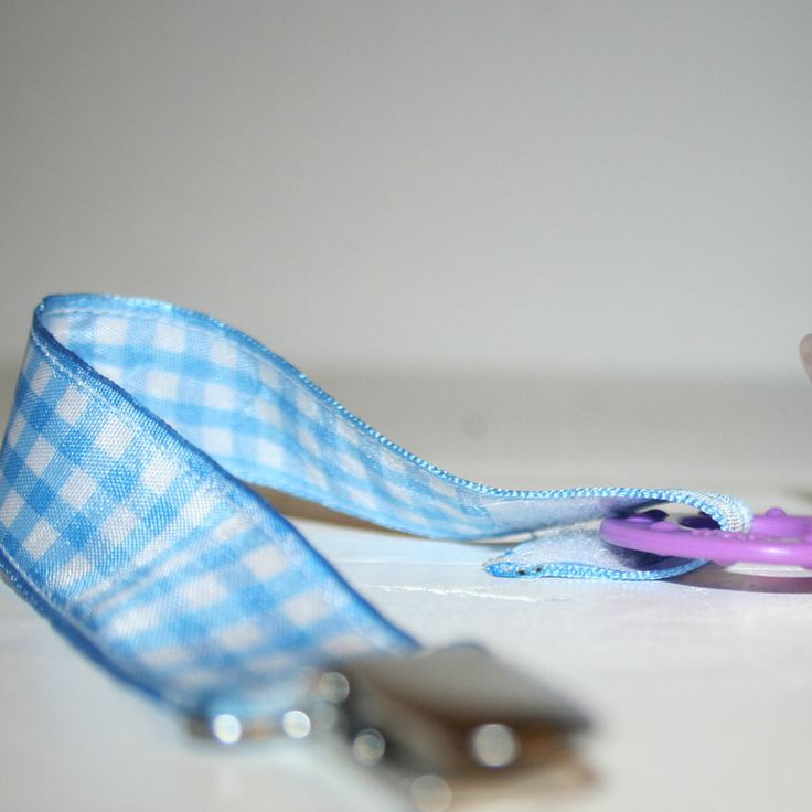 Light blue checkered pacifier holders on sale at Magoo. 3 for R100