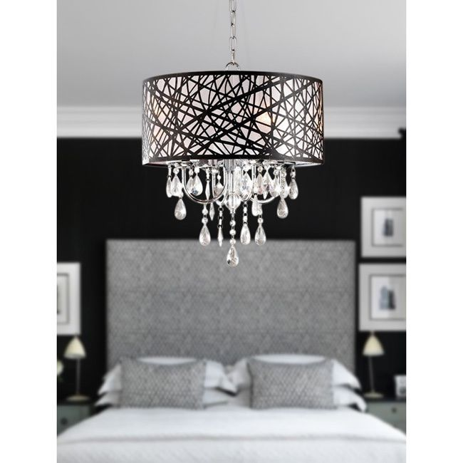 Illuminate your room of choice with this sparkling chrome chandelier. Reflecting off the chrome-finished shade and clear crystal, the four light bulbs produce a shimmering presence that lends elegance and atmosphere to its surroundings.