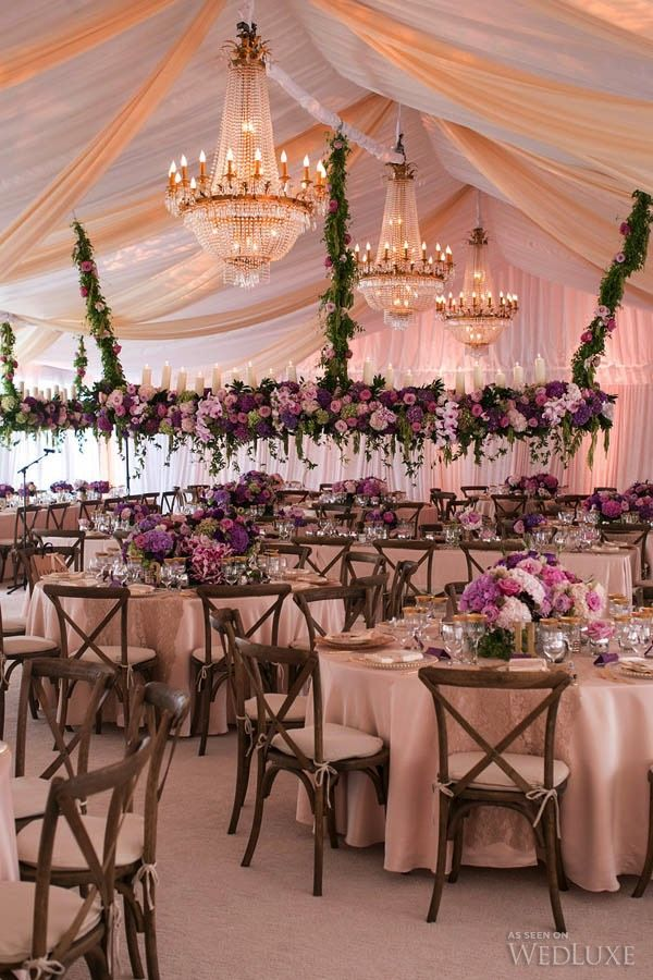 #Purple and #pink suspended floral arrangement and antique chandeliers | Photography: Sweet Pea Photography | WedLuxe Magazine #luxurywedding