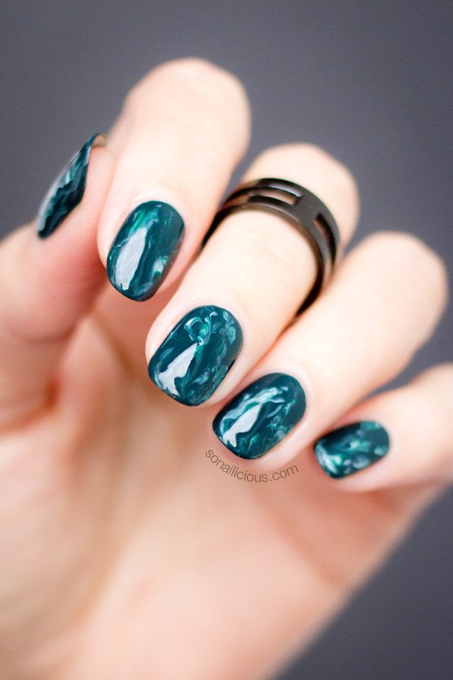 Green marble nails.