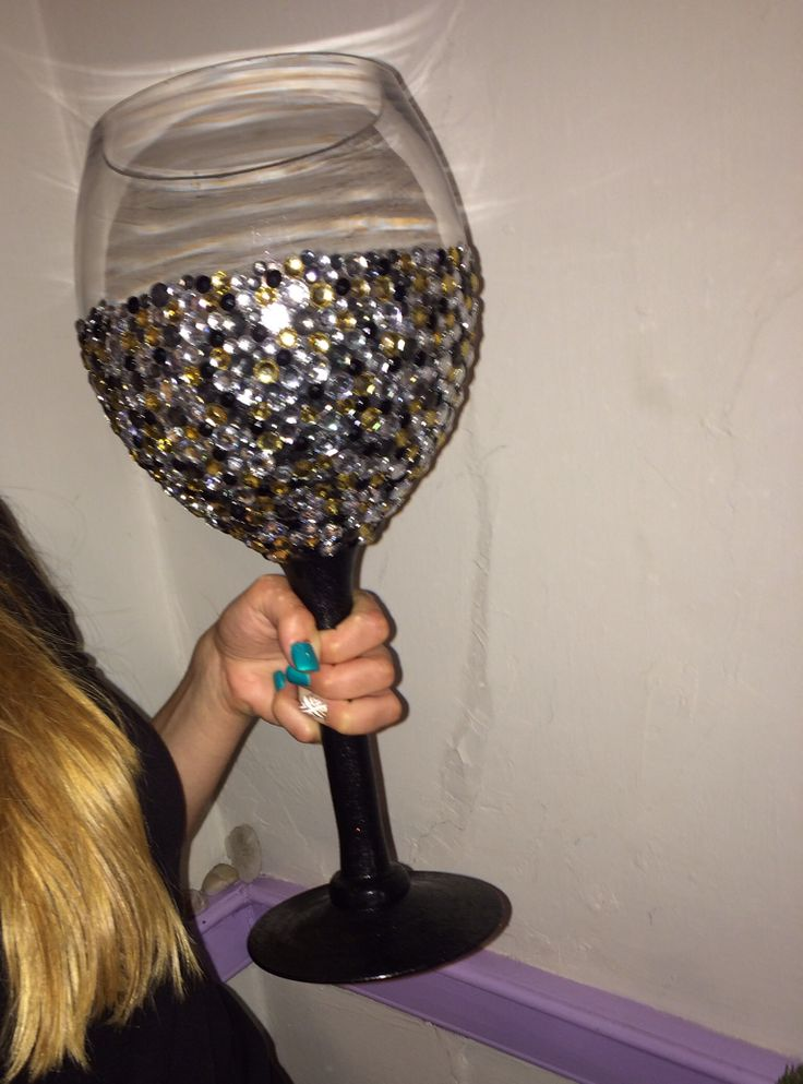 Studded giant wine glass, painted the stem with glass paint, oven set the glass then using mod podge placed all the studs. Bedazzled diy 21st birthday