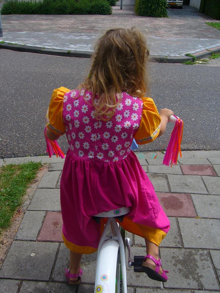 Jolie in her B-day Dress on her B-day Bike