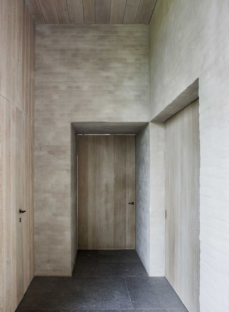 Oak, rendered brick and Belgian natural stone make for a traditional atmosphere. B-S Residence by Vincent van Duysen.