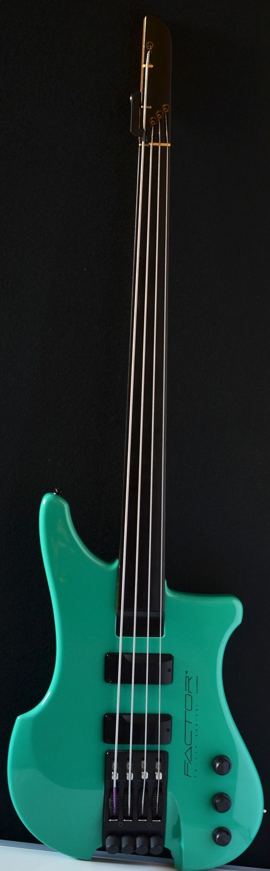 "Sea Green Kubicki Factor bass 4 string fretless bass. Company RESEARCH by #DdO:) - https://www.pinterest.com/claxtonw/bass-foundation/ - BASS FOUNDATION: If you would like to ""D"" tune your ""E"" string almost instantaneously, without changing string tension and not having to transpose, then the Ex Factor is your only choice. The Ex Factor 4 string bass has a 32"" scale and allows the ""E"" string to be released to a longer ""D"" length of 36"". Available with frets or fretless."