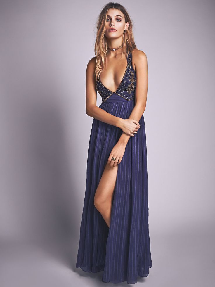 Golden Dawn Maxi | Beautiful floor length gown featuring an embellished bodice with bead and embroidery detailing. Crisscross back straps with cutouts and a hidden side zip closure. Crinkly skirt with a tonal dotted pattern.