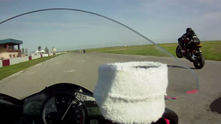 Video still from onboard Mike's bike during an AFM race in 2010. That's 136mph on his dial, and I'm wheelying past him in 3rd gear.....with another gear to go before touchdown.....and HARD braking for turn 1.....