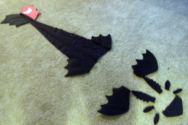 Toothless costume pieces..... put the tail on a belt and sew the other parts onto a hoodie