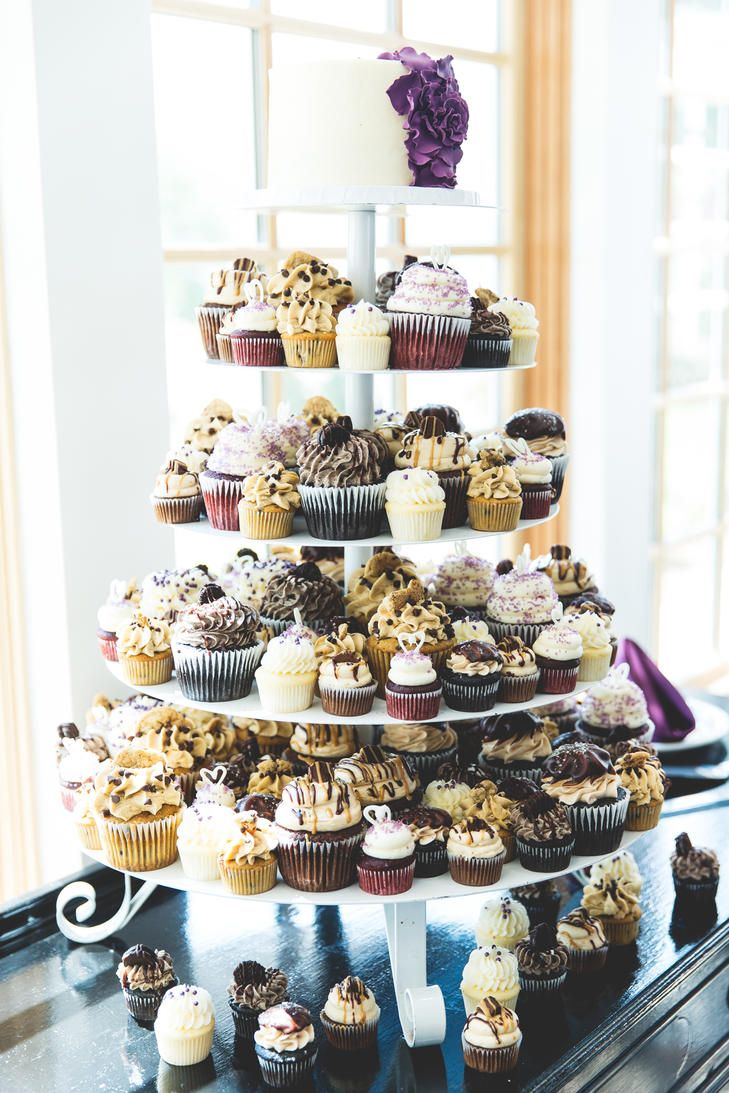 Not a wedding cake person? Opt for the cupcake route with an extravagant cupcake display for your reception.