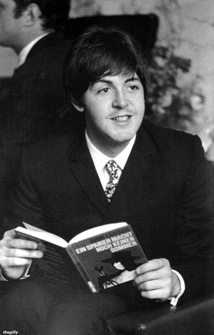 """Paul reading a German translation of John's second book """"A Spaniard in the Works"""" at the Hotel Bayerischer Hof in Munich, 24 June 1966. Photo by Robert Whitaker. Scan from """"Eight Days a Week"""" by Robert Whitaker and Marcus Hearn."""