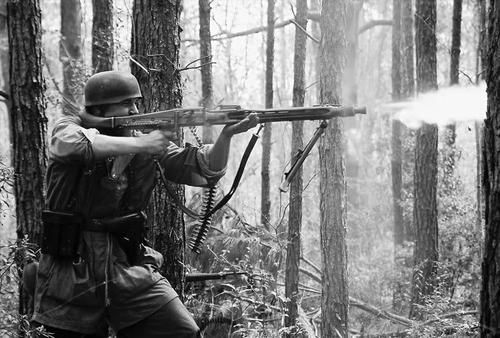 A German paratrooper firing a MG42. The standing position was not normally used with this hi-powered weapon. I'm sure the woods & surrounding terrain warranted it in this case....