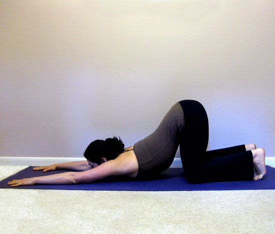 Extended Puppy    For your tight shoulders and upper back, this pose will feel amazing.    From Child's Pose, slide your hands and chest away from your feet so your hips are over your knees. Stay like this for five deep breaths.