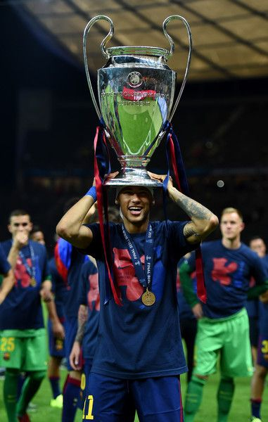 Neymar of Barcelona celebrates with the trophy after the UEFA Champions League Final between Juventus and FC Barcelona at Olympiastadion on June 6, 2015 in Berlin, Germany.