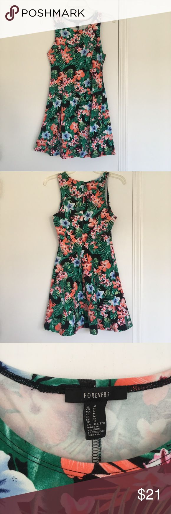 🌺 Tropical Print Floral A-Line Skater Dress 🌺 Amazing tropical print skater dress, fitted at waist, flaring out in the skirt.   Material is stretchy so it's super comfy.   Looks amazing with white sneaks and a pair of shades or under a hoodie or denim jacket!  Size M.  Contents: 96% Cotton, 4% Spandex/Elastane Condition: Very good. Worn a couple of times but no noticeable wear. Forever 21 Dresses
