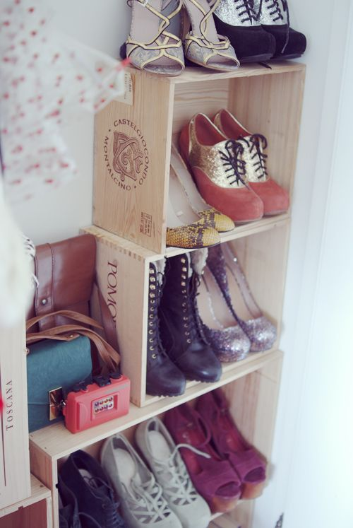 shoe shelves I made from my dads old wine crates, the perfect size! and I like the look of it.