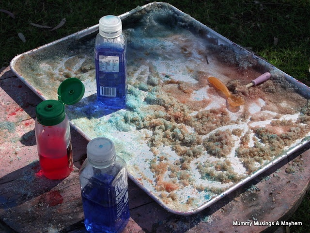 Sensory toddler fun and fine motor discovery with squeeze bottles and a salt tray!!