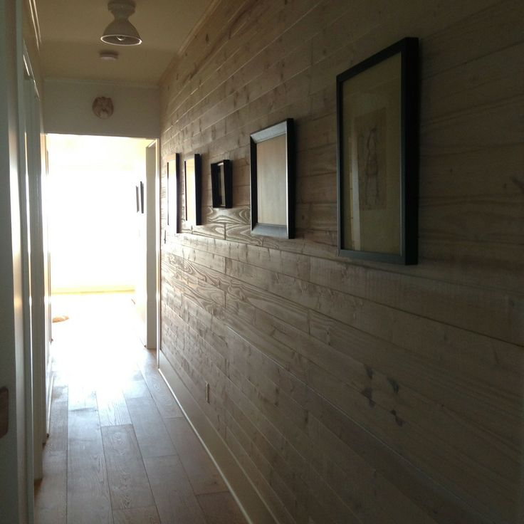 Hallway with natural wood paneling