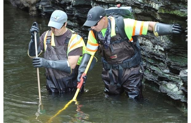 City workers from left Brian Bezair and Matt Rozak use an ElectorFisher to find eels coming from one of the water tunnels at the Fleet Street Pumping Station.