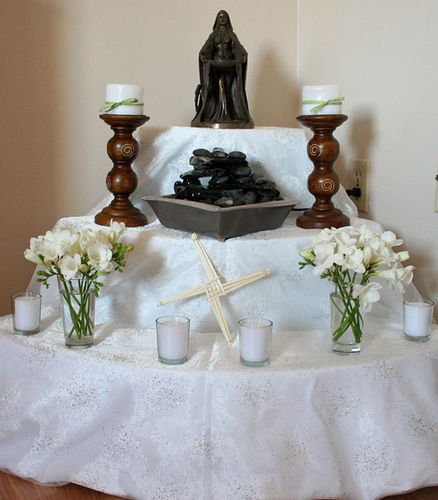 Imbolc/Candlemas goddess altar with Brighid's Cross down front and center. St. Brighid is honored at Imbolg in the Wiccan religion.