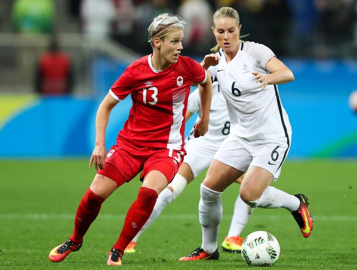 Sophie Schmidt (L) of Canada and of Amandine Henry of France in action during…