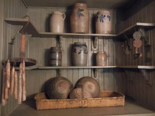 Green Beadboard Pantry...Old woven mustard basket, olde crocks, hand dipped candles...