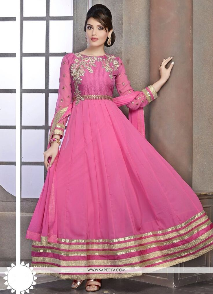 Glorious pink georgette anarkali suit designed with resham, zari, applique, lace and patch border work. Available with shantoon churidar and faux chiffon dupatta. (Slight variation in color is possibl...