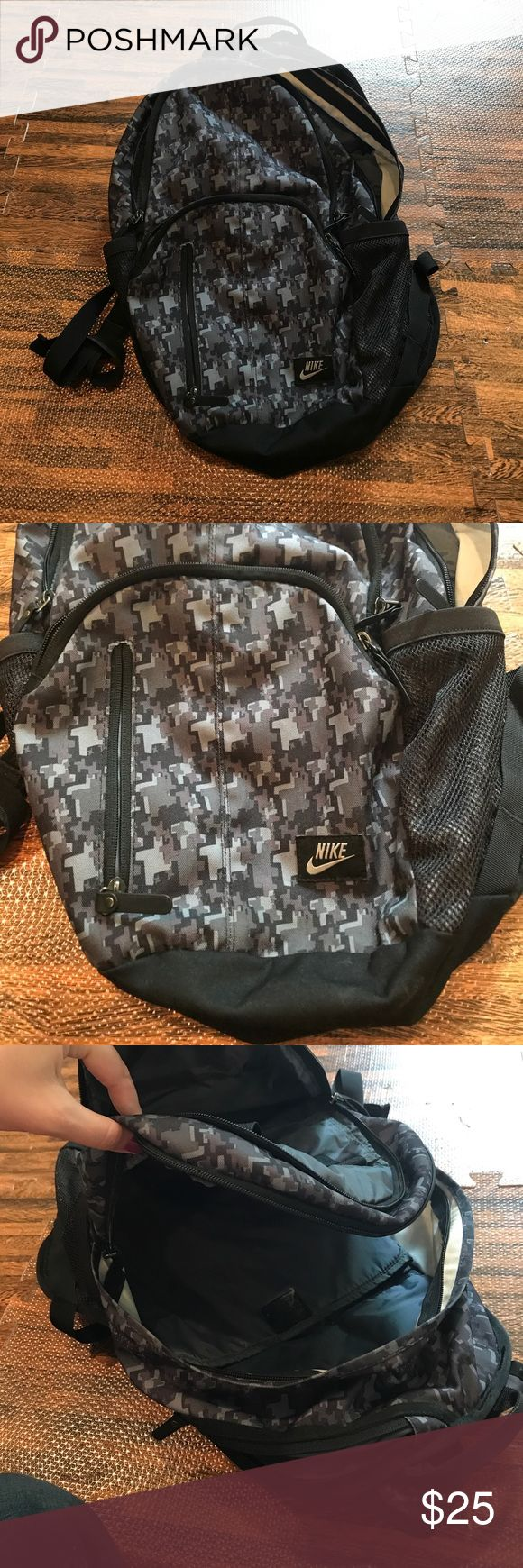 Nike backpack Great backpack with lots of zippered compartments to store stuff as well as 2 mesh pockets on the sides great for water bottles! Used but still in good condition Nike Bags Backpacks