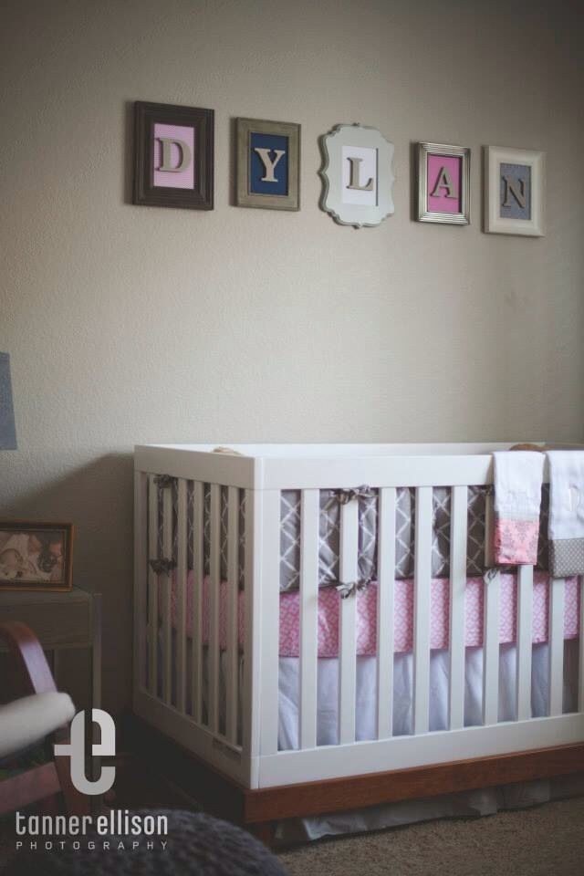 Pink and grey nursery. Love the idea of different frames with the name  above the crib.
