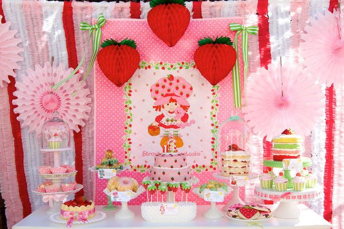 Strawberry Shortcake birthday dessert table || via Sweet Designs by Amy Atlas. Design  styling: Minted and Vintage. Carolina Tourgeman Photography. Polydot Printing. Shop Sweet Lulu. Seasonal Display. Chic Events. Dainty Tutus  Bows. Dnichys Cakes and Cookies. Giggling Goodies. Frans House of Dolls  Toys.