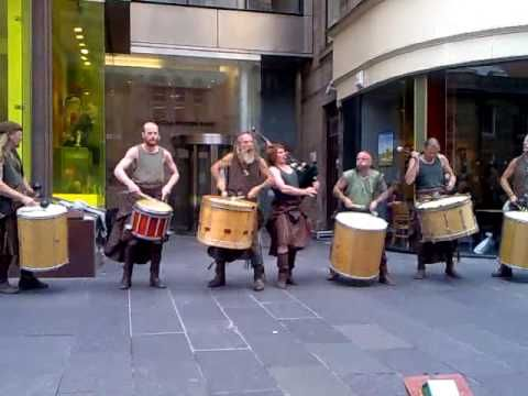 "Scottish band of Drummers (Clanadonia), performing with their drums in Buchanan street in Glasgow City Centre.   Music is ""The Gael"" from the movie ""Last of the Mohicans"".   It was great to listen to it live."
