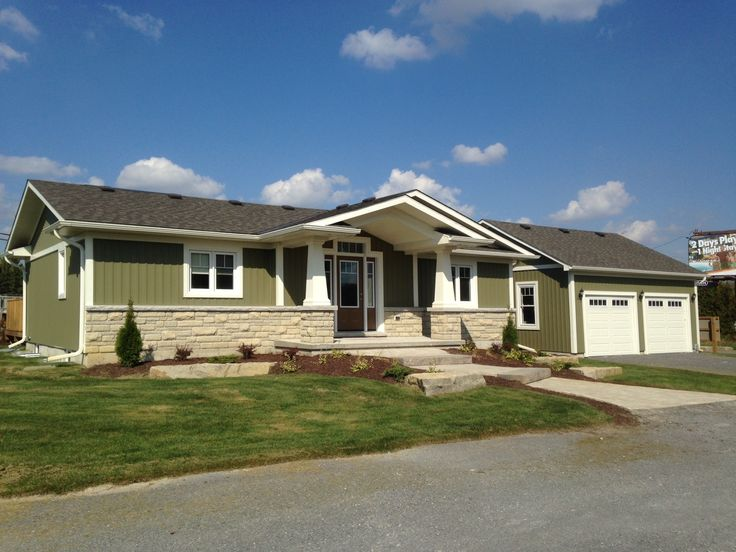 Beautifully finished exterior of the Bluewater Model featuring vinyl Board & Batton siding and Citadel stone kneewall