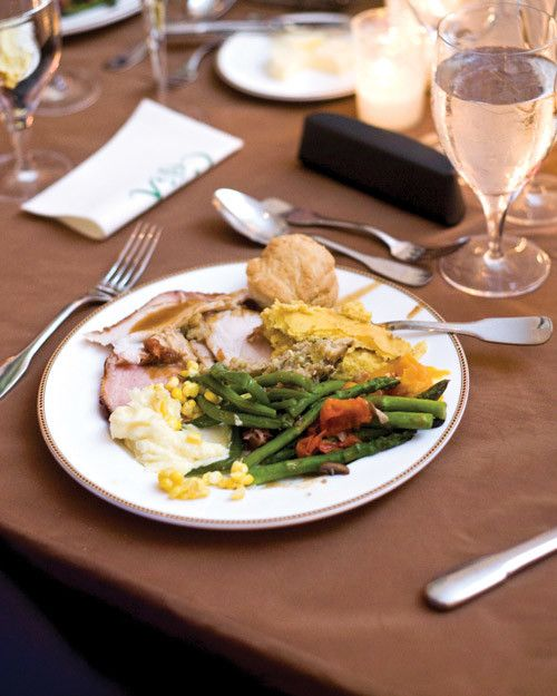 The rehearsal dinner at Caroline and Keating's Thanksgiving wedding was a veritable fall feast, including turkey with stuffing and cranberries, glazed ham with cornbread pudding, mashed potatoes, and biscuits.