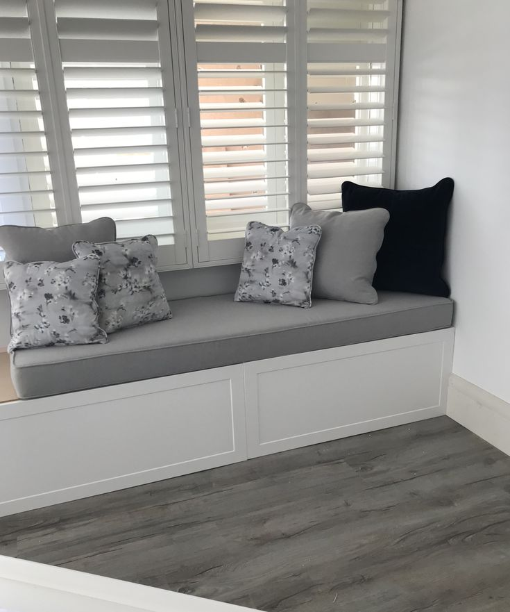 Albedor Sheree doors in Satin White. Beautiful sitting area. Joinery by H R & R H Enterprises.