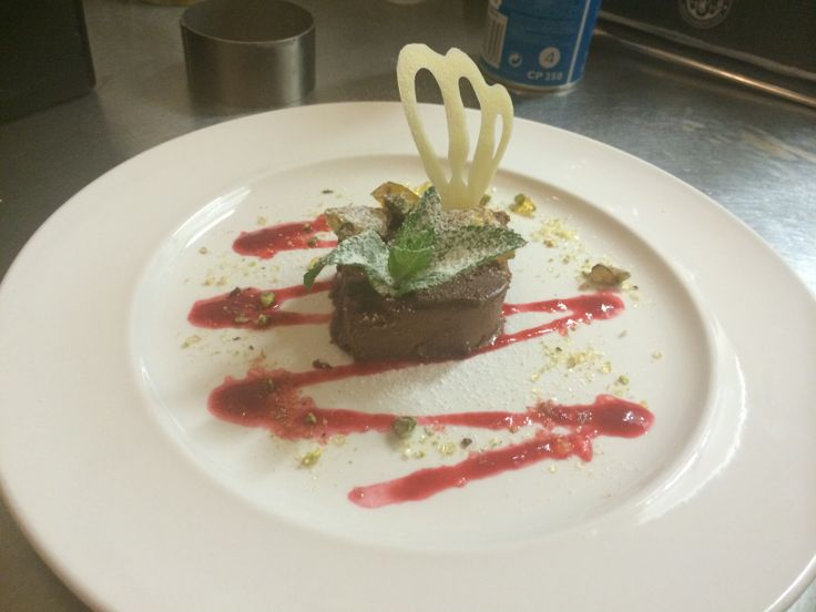 Chocolate marquise, raspberry coulis, caramelised pistachios