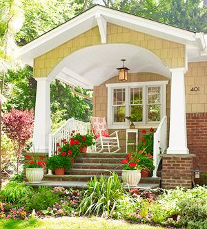 Pretty porch- same idea for front- like the columns on a base so the stairs can be covered.