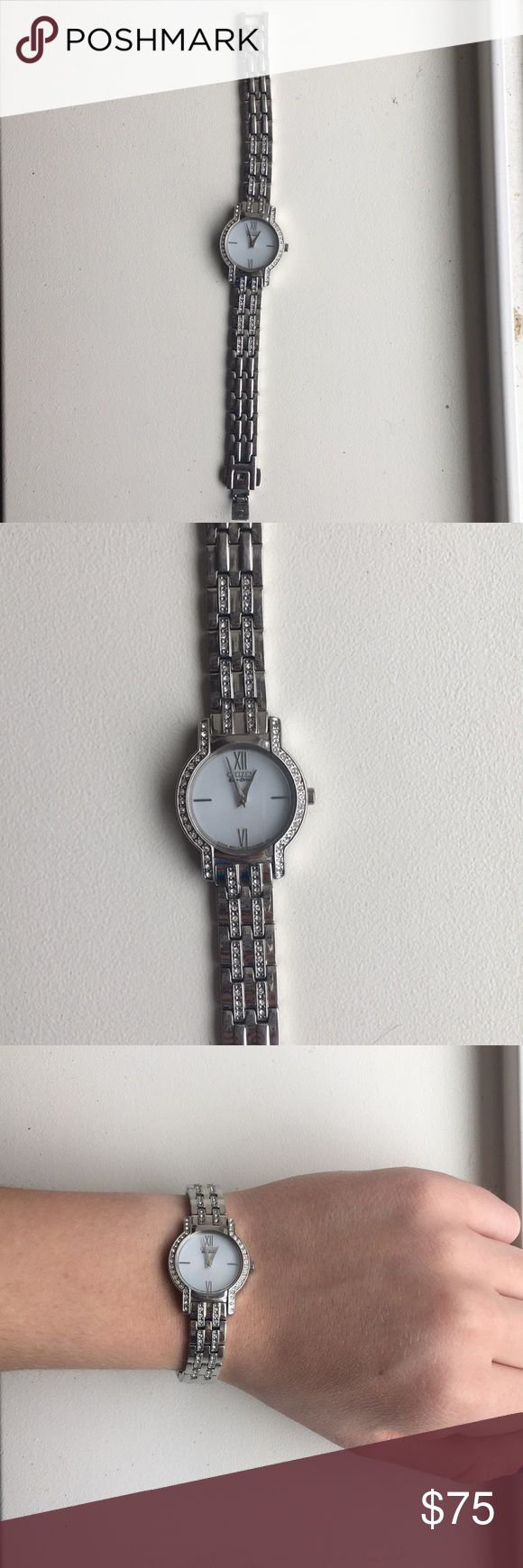 Citizen eco drive silver watch Beautiful citizen watch! Water resistant, has diamonds along the band and around the edges of the watch. Completely working with no scratches! Citizen Accessories Watches