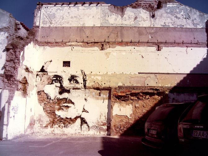 """Alexandre Farto (aka Vhils) started with the idea of turning photos into stencils. Instead of using spray paint though, he scratched portraits into walls around Moscow http://restreet.altervista.org/la-tecnica-esplosiva-di-vhils/"