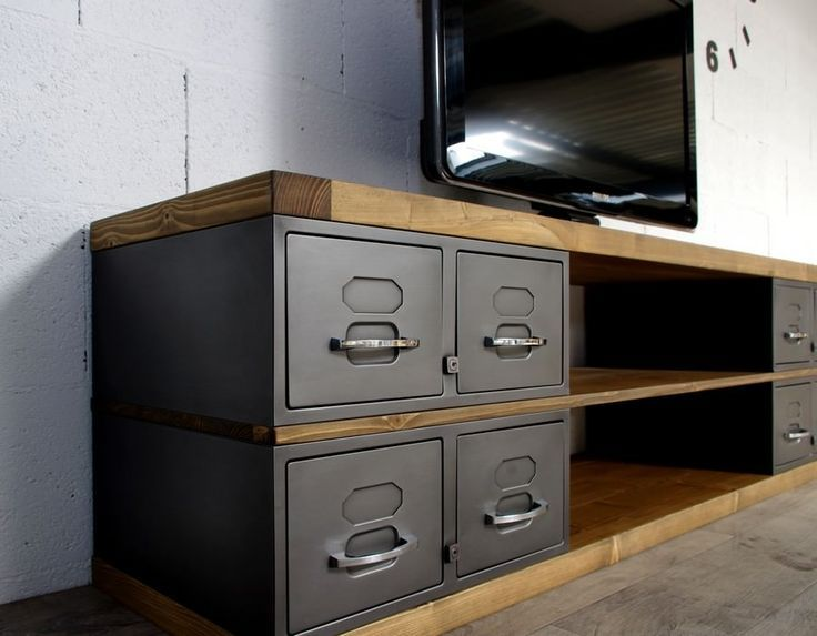 TV cupboard fabricated from metal and industrial wooden oak or spruce. creation time