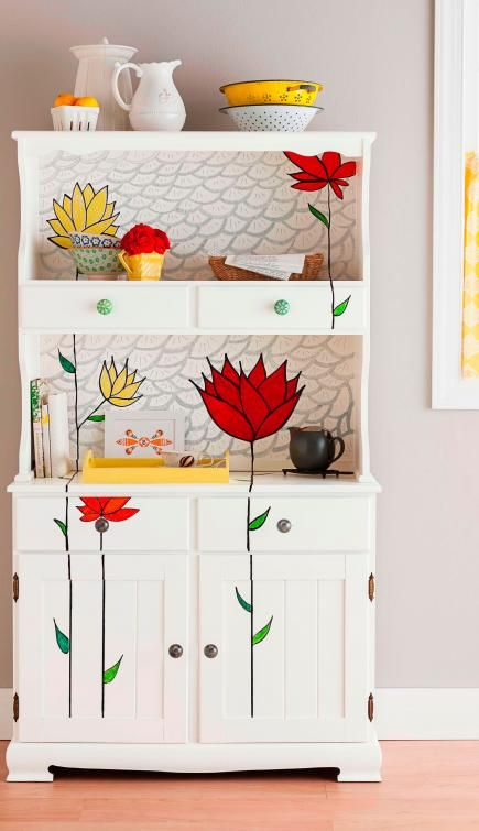 DIY Furniture Makeovers - bold-color flowers renew the look of this cabinet, bright white and a subtle pattern keep the attention on the blossoms.