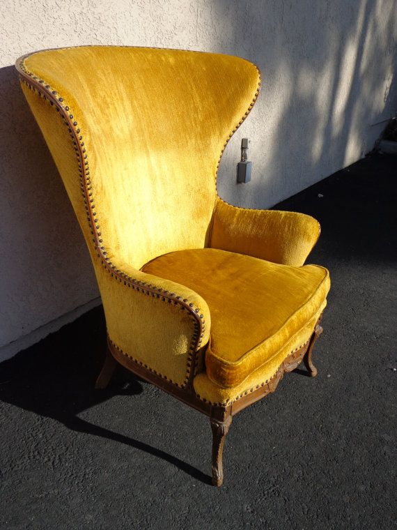 incredibly awesome vintage high wing back chair by