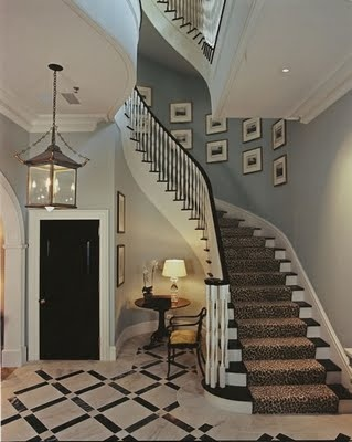 Pale blue walls, lantern, animal print stair runner, black and white patterned
