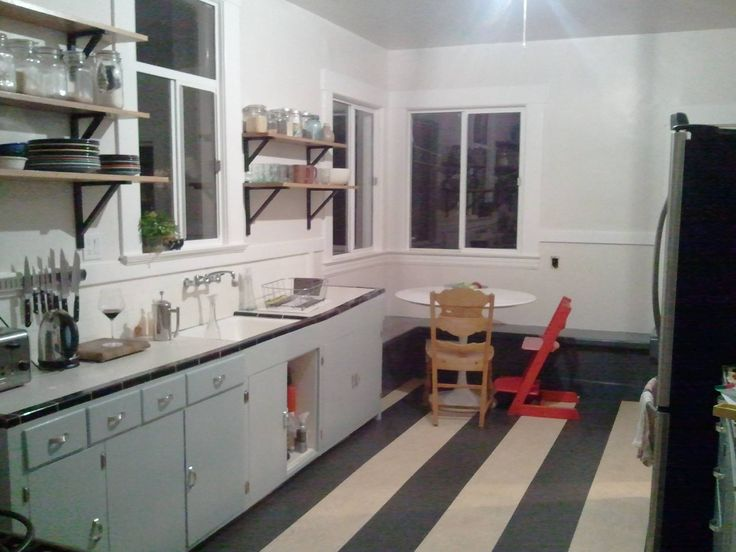Cabinets painted, new marmoleum click floor, shelves being installed and new tulip table.